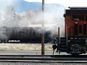 The fire burning itself out, with an empty coal train in the background.