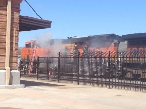 Smoke billowing off the locomotive